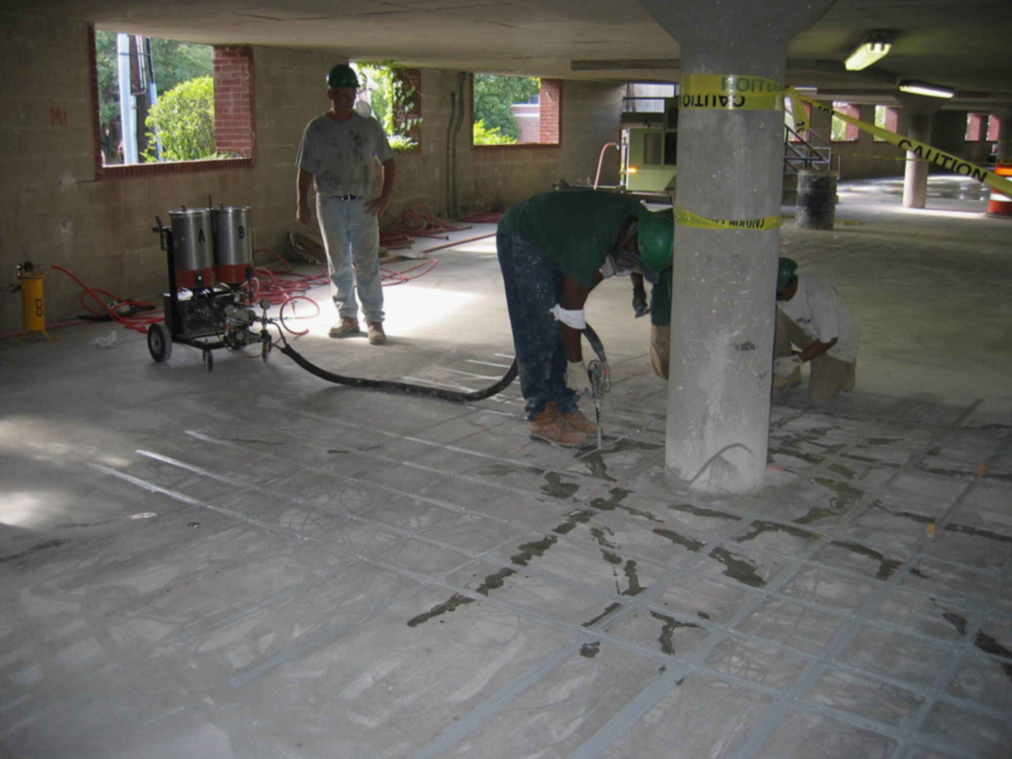 Case Study: Strengthening of Parking Garage Decks with Near-Surface
